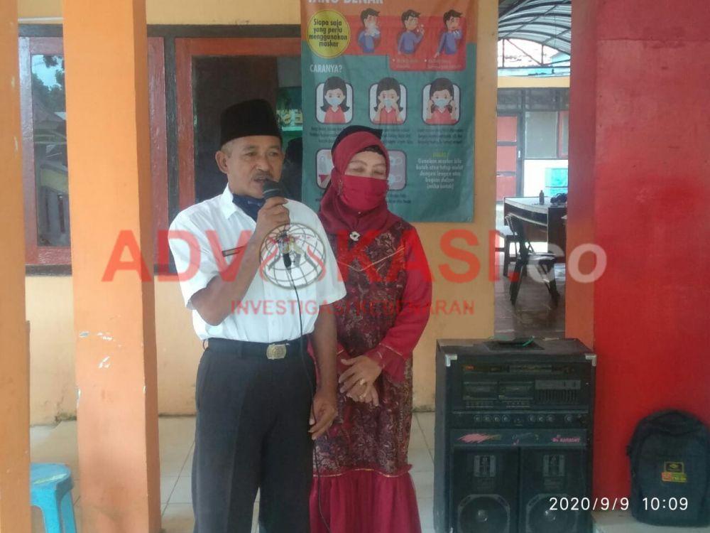 Moh Toha dan istri. (foto : wahyu/advokasi.co)